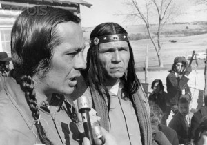 07 Mar 1973, Wounded Knee, South Dakota, USA --- Two leaders of the American Indian Movement Russell Means and Dennis Banks appear grim after meeting  with all the Indians at Wounded Knee, South Dakota, on the Pine Ridge Reservation.  Government officials proposed that the Indians leave Wounded Knee peaceably and have given the Indians until 6pm March 8th, to do so. --- Image by © Bettmann/Corbis